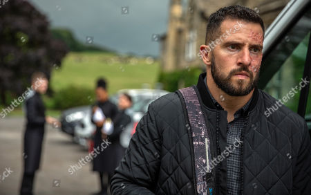 Stock Photo of Ep 8280 & 8281 Tuesday 9th October 2018 Ross Barton, as played by Michael Parr, is stunned when he is confronted by suspicious Moira Dingle, as played by Natalie J Robb, who has worked out his plan and tries to talk him out of it. He puts her off the scent and soon after spotting Simon, as played by Liam Ainsworth.