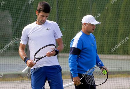 Novak Djokovic (L) reacts with his coach Marian Vajda (R) during his open training session in Belgrade, Serbia, 01 October 2018.