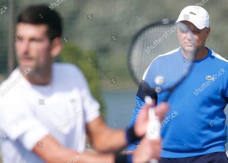 Coach Marian Vajda, right, looks Serbian tennis player Novak Djokovic returns the ball during his open practise session in Belgrade, Serbia