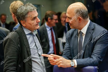 Greek Finance Minister Euclid Tsakalotos (L) and European Commissioner for Economic and Financial Affairs Pierre Moscovici (R) at the start of the Eurogroup meeting in Luxembourg, 01 October 2018. The Eurogroup is holding its thematic discussions on jobs and growth and will focus on national automatic stabilisers. Ministers will discuss the reform of the European Stability Mechanism (ESM).