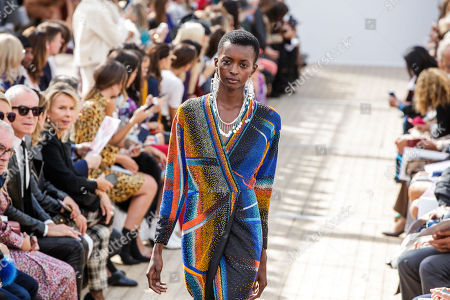 Stock Photo of Amira Pinheiro presents a creation of the Spring/Summer 2019 Women's collection by French designer Christine Phung for Leonard fashion house during the Paris Fashion Week, in Paris, France, 01 October 2018. The presentation of the Women's collections runs from 24 September to 02 October.