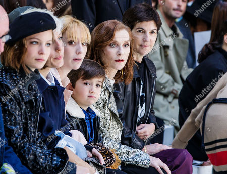 French actress Isabelle Hubert (C-R), her daughter actress Lolita Chammah (C-L) and French writer Christine Angot (R) attend the presentation of the Spring/Summer 2019 Women's collection by French designer Agnes B. during the Paris Fashion Week, in Paris, France, 01 October 2018. The presentation of the Women's collections runs from 24 September to 02 October.