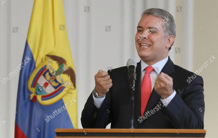 Colombian President Ivan Duque offers a press meeting after he signs a decree that will authorize Police to confiscate personal amount of drugs or forbidden substances, in Bogota, Colombia, 01 October 2018. Duque is keeping to one of the presidential campaign promises to Colombians by reversing laws passed by his predecessor Juan Manuel Santos that aimed to decriminalize small amounts of drugs for personal use. The new decree would enable police to confiscate small doses of drugs that were previously legalized for personal use.
