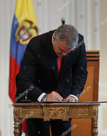 Colombian President Ivan Duque signs a decree that will authorize Police to confiscate personal amount of drugs or forbidden substances, in Bogota, Colombia, 01 October 2018. Duque is keeping to one of the presidential campaign promises to Colombians by reversing laws passed by his predecessor Juan Manuel Santos that aimed to decriminalize small amounts of drugs for personal use. The new decree would enable police to confiscate small doses of drugs that were previously legalized for personal use.