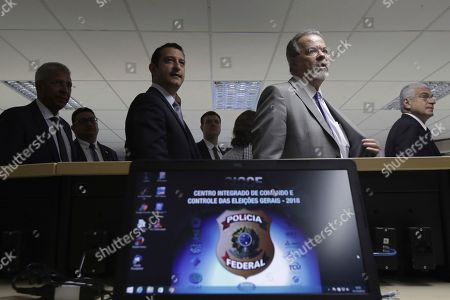 Stock Photo of Brazil's Minister of Public Security Raul Jungmann, second right, takes part in the opening activities of the Integrated Center for Command and Control of General Elections, at Federal Police headquarters in Brasilia, Brazil, . According to the Federal Police, the command and control center is composed of federal government and electoral justice institutions and has the objective of operational planning and security for the Brazilian general elections on October 7