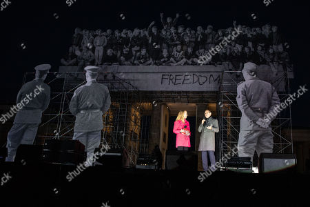 Stock Image of Governing Mayor of Berlin, Michael Mueller (R) and RBB tv host Petra Gute (L) on stage under the Brandenburg Gate, during the opening night of festival of 'Day of German Unity', in Berlin, Germany, 01 October 2018. 'Day of German Unity' commemorating the unification of the once divided country on 03 October. This year celebrations in the capital are expected to be more vast as Berlin holds the presidency of the Unification Day.