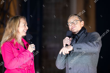 Governing Mayor of Berlin, Michael Mueller (R) and RBB tv host Petra Gute (L) on stage under the Brandenburg Gate, during the opening night of festival of 'Day of German Unity', in Berlin, Germany, 01 October 2018. 'Day of German Unity' commemorating the unification of the once divided country on 03 October. This year celebrations in the capital are expected to be more vast as Berlin holds the presidency of the Unification Day.