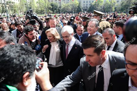 President of Chile, Sebastian Piñera (C); and the first lady, Cecilia Morel (C-L), leave the Palacio de La Moneda after a press conference, in Santiago, Chile, 01 October 2018. Pinera affirmed that the International Court of Justice (ICJ) of The Hague has 'made justice' after rejecting the Bolivian lawsuit demanding access to the Pacific sea, and offered a hand to Evo Morales' Government to colaborate and establish a dialogue in bilateral issues.