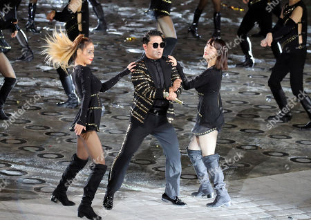 South Korean singer-rapper Psy (C) performs during a ceremony to mark the 70th anniversary of Armed Forces Day at the War Memorial of Korea in central Seoul , South Korea, 01 October 2018.