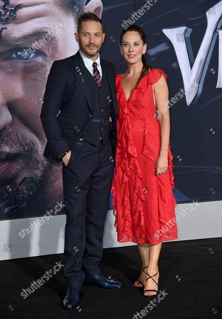 """Tom Hardy, Kelly Marcel. Actor Tom Hardy, left, and writer Kelly Marcel arrive at the world premiere of """"Venom"""", at the Regency Village Theater in Los Angeles"""