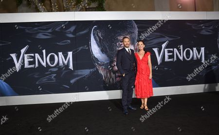 Tom Hardy and Kelly Marcel, Writer, at Columbia Pictures' VENOM World Premiere at the Regency Village Theater