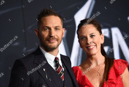 Stock Photo of Tom Hardy and Kelly Marcel, Writer, at Columbia Pictures' VENOM World Premiere at the Regency Village Theater