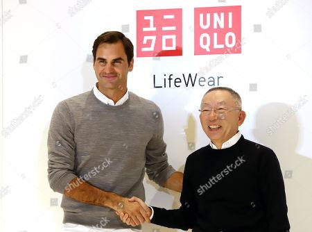 Roger Federer shakes hands with Japan's fast fashion giant Uniqlo president Tadashi Yanai