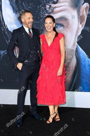 British actor/cast member Tom Hardy (L) and British screenwriter Kelly Marcel arrive for the premiere of Columbia Pictures' 'Venom' at the Regency Village Theater in Westwood, Los Angeles, California, USA, 01 October 2018 (issued 02 October 2018). The movie opens in the US on 05 October 2018.