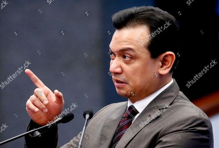 """Opposition Senator Antonio Trillanes IV points to a malfunctioning power point presentation as he delivers a """"privilege speech"""" before the Philippine Senate, in suburban Pasay city, south of Manila, Philippines. Trillanes holed himself up for 25 days in the Philippine Senate after President Rodrigo Duterte voided his amnesty when he staged a coup against then President Gloria Macapagal Arroyo and refuted the threat of an arrest order by presenting pieces of evidence to prove that his amnesty was legal"""