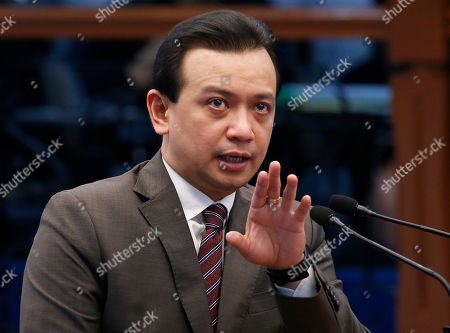 """Opposition Senator Antonio Trillanes IV gestures as he delivers a """"privilege speech"""" before the Philippine Senate, in suburban Pasay city south of Manila, Philippines. Trillanes holed himself up for 25 days in the Philippine Senate after President Rodrigo Duterte voided his amnesty when he staged a coup against then President Gloria Macapagal Arroyo and refuted the threat of an arrest order by presenting pieces of evidence to prove that his amnesty was legal"""