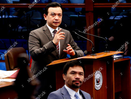 """Antonio Trillanes IV, Manny Pacquiao. Opposition Senator Antonio Trillanes IV gestures as he delivers a """"privilege speech"""" before the Philippine Senate, in suburban Pasay city south of Manila, Philippines. Trillanes holed himself up for 25 days in the Philippine Senate after President Rodrigo Duterte voided his amnesty when he staged a coup against then President Gloria Macapagal Arroyo and refuted the threat of an arrest order by presenting pieces of evidence to prove that his amnesty was legal. In the foreground is Filipino boxing champion and now Senator Manny Pacquiao"""