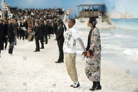 US singer Pharrell Williams (L) and Helen Lasichanh present a creation from the Spring/Summer 2019 Women's collection by German designer Karl Lagerfeld for Chanel at the Grand Palais during the Paris Fashion Week, in Paris, France, 02 October 2018. The presentation of the Women's collections runs from 24 September to 02 October.