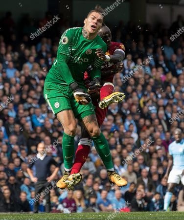 Stock Image of Manchester City's Goalkeeper Ederson Santana De Moraes (l) Is Fouled By Liverpool's Sadio Mane During The English Premier League Soccer Match Between Manchester City And Liverpool Fc At The Etihad Stadium In Manchester Britain 09 September 2017. Mane Would Be Sent Off For The Challenge And City Would Go Onto Win The Game 5-0.
