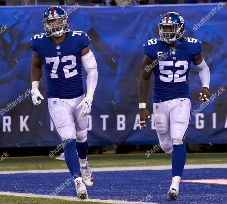East Rutherford, New Jersey, U.S. - New York Giants defensive end Kerry Wynn (72) and linebacker Alec Ogletree (52) during a NFL game between the New Orlean Saints and the New York Giants at MetLife Stadium in East Rutherford, New Jersey. The Saints defeated the Giants 33-18