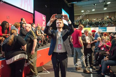 Jeremy Corbyn's Speech On The Final Day Of Labour Party Conference In Brighton. Corbyn's Son Thomas Corbyn Takes A Picture Of The Auditorium.