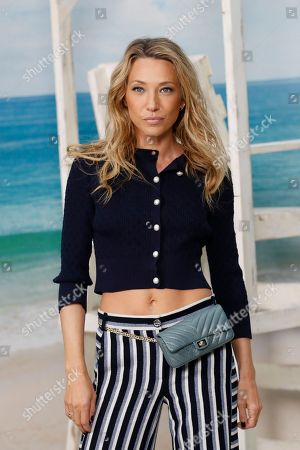 French actress Laura Smet poses during a photocall before the presentation of Chanel Spring/Summer 2019 ready-to-wear fashion collection in Paris, Tuesday, Oct.2, 2018