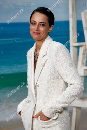 French novelist Anne Berest poses during a photocall before the presentation of Chanel Spring/Summer 2019 ready-to-wear fashion collection in Paris, Tuesday, Oct.2, 2018