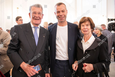 German photographer Wolfgang Tillmans (C) poses for a photo with his parents Elisabeth (R) and Karl Adolf (L) Tillmans after  a ceremony at Bellevue Palace in Berlin, Germany, 02 October 2018. The Order of Merit of the Federal Republic of Germany is awarded by the President to honour achievements of particular value to society.