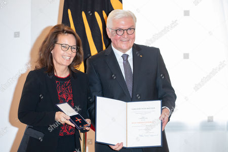 German President Frank-Walter Steinmeier (R) awards the Order of Merit to German film director Caroline Link (L) during a ceremony at Bellevue Palace in Berlin, Germany, 02 October 2018. The Order of Merit of the Federal Republic of Germany is awarded by the President to honour achievements of ?particular value to society?.