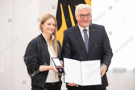 German President Frank-Walter Steinmeier (R) awards the Order of Merit to Swiss actress Julia Jentsch (L) during a ceremony at Bellevue Palace in Berlin, Germany, 02 October 2018. The Order of Merit of the Federal Republic of Germany is awarded by the President to honour achievements of ?particular value to society?.