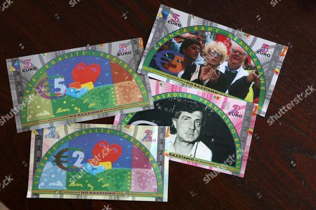 Stock Picture of A picture made available on 02 October 2018 shows the banknotes with the image of  Italian psychiatrist Franco Basaglia, Italian writer Franca Rame and Nobel prize Dario Fo, in Riace, Italy, 06 April 2018. The 'currency', in the form of bonds issued by the Municipality, is one of the initiatives promoted by the Mayor of Riace Domenico Lucano to allow migrants hosted in Riace to make purchases of basic necessities in shops specifically affiliated with the institution. Riace Mayor Domenico 'Mimmo' Lucano was put under house arrest on 01 September in relation to allegations of aiding illegal immigration, prosecutors said. The arrest warrant, performed by finance police, also referred to alleged wrongdoing over the direct assignment of trash-collection services without a public tender. Lucano's administration of the town in the southern region of Calabria has been frequently lauded by commentators for the way migrants were integrated into the local community and made a positive contribution to it.  He was named among Fortune's 50 greatest world leaders in 2016.