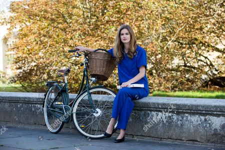 Former Miss World finalist  Carina Tyrrell back in Cambridge wearing her scrubs before she hangs them up to do a Master degree at the University