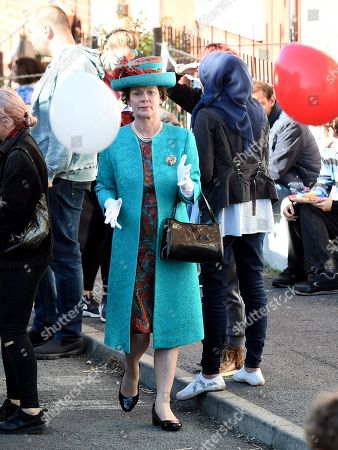Samantha Bond plays the Queen