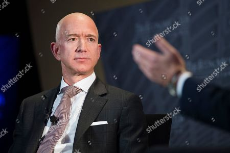 """Jeff Bezos, Amazon founder and CEO, speaks at The Economic Club of Washington's Milestone Celebration in Washington. Amazon, which has faced political and economic pressure to raise pay for thousands of employees, is boosting its minimum wage for all U.S. workers to $15 per hour starting next month and said it will push for an increase in the federally mandated minimum wage, which now stands at $7.25 per hour. """"We listened to our critics, thought hard about what we wanted to do, and decided we want to lead,"""" said Bezos"""
