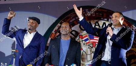 Lennox Lewis, Evander Holyfield, Vitali Klitschko. Former heavyweight champions Lennox Lewis, left, Evander Holyfield, center, and former heavyweight champion, now Kiev Mayor Vitali Klitschko, gesture to the crowd, during an event at the 56th Convention of the World Boxing Council (WBC), in Kiev, Ukraine