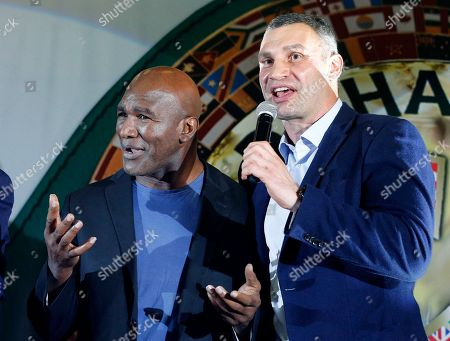 Evander Holyfield, Vitali Klitschko. Former heavyweight champion Evander Holyfield, left, and former heavyweight champion, now Kiev Mayor Vitali Klitschko, gesture to the crowd, during an event at the 56th Convention of the World Boxing Council (WBC), in Kiev, Ukraine