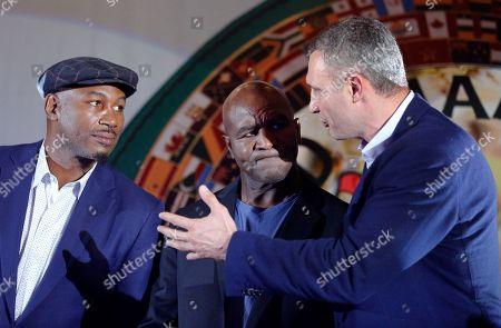 Evander Holyfield, Vitali Klitschko. Former heavyweight champions Lennox Lewis, left, Evander Holyfield, center, and former heavyweight champion, now Kiev Mayor Vitali Klitschko, react at an event, during the 56th Convention of the World Boxing Council (WBC), in Kiev, Ukraine