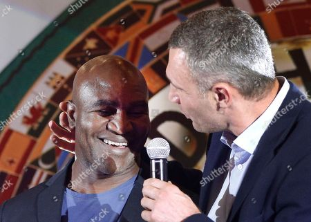 Evander Holyfield, Vitali Klitschko. Former heavyweight champion now Kiev Mayor Vitali Klitschko, right, examines former heavyweight champion Evander Holyfield's ear that Mike Tyson bit in a bout, during the 56th Convention of the World Boxing Council (WBC), in Kiev, Ukraine