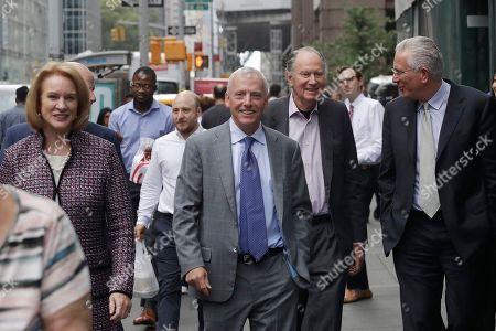 Seattle Mayor Jenny Durkan, left, walks with Seattle Hockey Partners David Wright, center, David Bonderman, second from right, and Tim Leiweke as they leave a meeting at National Hockey League headquarters, in New York. Members of Seattle's potential ownership group and Mayor Durkan presented their case to the Board of Governors' executive committee at the league office. If the executive committee moves the process forward, the board could vote as soon as December to award the NHL's 32nd franchise to Seattle