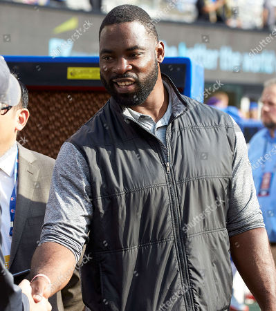 East Rutherford, New Jersey, U.S. - Former New York Giants defensive end Justin Tuck was on the sideline prior to a NFL game between the New Orlean Saints and the New York Giants at MetLife Stadium in East Rutherford, New Jersey. The Saints defeated the Giants 33-18