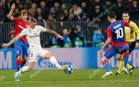 Stock Photo of Real midfielder Toni Kroos, left, kicks the ball ahead of CSKA midfielder Alan Dzagoev during a Group G Champions League soccer match between CSKA Moscow and Real Madrid at the Luzhniki Stadium in Moscow, Russia