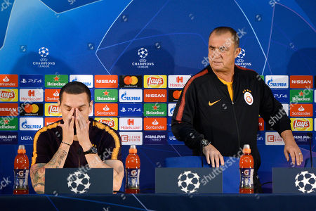 Galatasaray's head coach Fatih Terim (R) and his player Maicon attend a press conference at Dragao stadium in Porto, Portugal, 02 October 2018. Galatasaray will face FC Porto in their UEFA Champions League Group D soccer match on 03 October 2018.