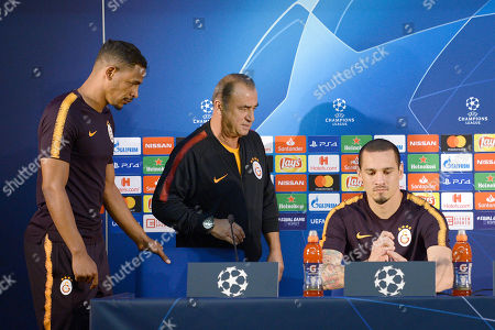 Galatasaray's head coach Fatih Terim (C), Fernando (L) and Maicon (R) attend a press conference at Dragao stadium in Porto, Portugal, 02 October 2018. Galatasaray will face FC Porto in their UEFA Champions League Group D soccer match on 03 October 2018.