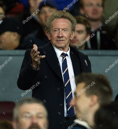 Former Manchester United player Denis Law looks on from the stand