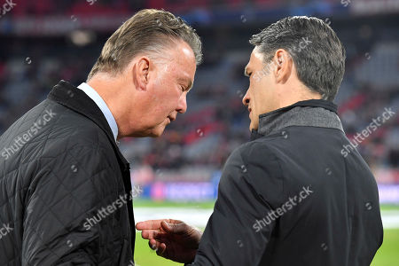 Dutch football manager Louis van Gaal, left, talks to Bayern coach Niko Kovac prior to a Group E Champions League soccer match between Bayern Munich and Ajax at the Allianz Arena in Munich, Germany