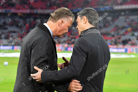 Dutch football manager Louis van Gaal, left, talks to Bayern coach Niko Kovac, right, prior to a Group E Champions League soccer match between Bayern Munich and Ajax at the Allianz Arena in Munich, Germany