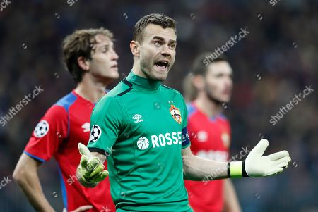 CSKA goalkeeper Igor Akinfeev reacts during the Group G Champions League soccer match between CSKA Moscow and Real Madrid at the Luzhniki Stadium in Moscow, Russia