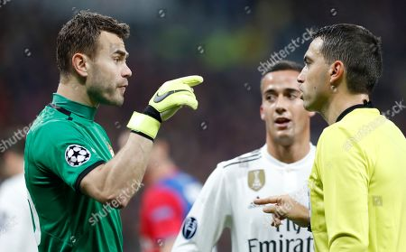 CSKA goalkeeper Igor Akinfeev, left, argues with a referee during the Group G Champions League soccer match between CSKA Moscow and Real Madrid at the Luzhniki Stadium in Moscow, Russia