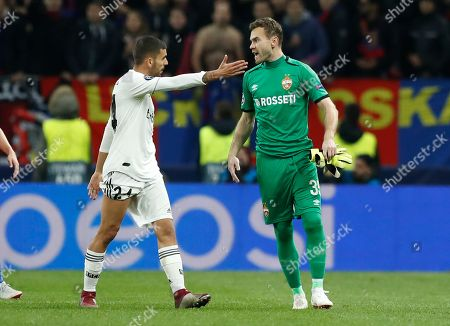CSKA goalkeeper Igor Akinfeev, right, argues with Real midfielder Dani Ceballos during the Group G Champions League soccer match between CSKA Moscow and Real Madrid at the Luzhniki Stadium in Moscow, Russia