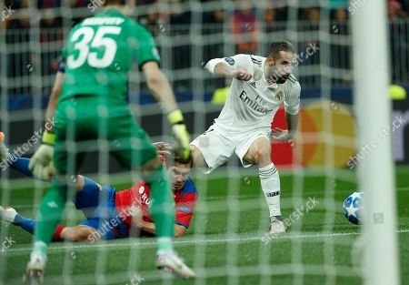 Dani Carvajal of Real Madrid (R) in action against Kirill Nababkin (C) and Igor Akinfeev of PFC CSKA during the UEFA Champions League group G soccer match between PFC CSKA Moskva and Real Madrid CF at the Luzhniki stadium in Moscow, Russia, 02 October 2018.